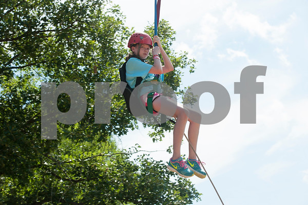 Rylee Stanley, 12, of Tyler rides the zip line at Girls in Action camp at Timberline Camp in Lindale Thursday June 9, 2016. Girls in Action and is a missions discipleship organization for girls in first through sixth grades.  (Sarah A. Miller/Tyler Morning Telegraph)