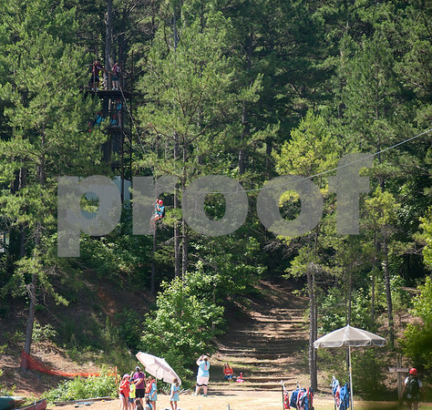 Mackenzie Bergen, 12, of Winona, rides the zip line at Girls in Action camp at Timberline Camp in Lindale Thursday June 9, 2016. Girls in Action and is a missions discipleship organization for girls in first through sixth grades.  (Sarah A. Miller/Tyler Morning Telegraph)