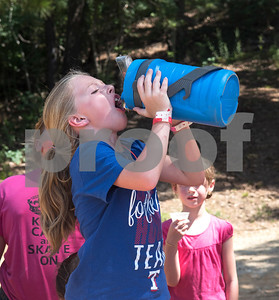 Riley Roberts, 10, of Tyler, drinks water during Girls in Action camp at Timberline Camp in Lindale Thursday June 9, 2016. Girls in Action and is a missions discipleship organization for girls in first through sixth grades.  (Sarah A. Miller/Tyler Morning Telegraph)
