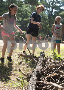 Kamey Kirby, 10, of Bullard, Ashlynn Harris, 15, of Whitehouse and Charli Martin, 11, of Whitehouse, clean up an outdoor area as part of a mission project at Girls in Action camp at Timberline Camp in Lindale Thursday June 9, 2016. Girls in Action and is a missions discipleship organization for girls in first through sixth grades.  (Sarah A. Miller/Tyler Morning Telegraph)