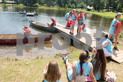 Girls use paddle boats and canoes during Girls in Action camp at Timberline Camp in Lindale Thursday June 9, 2016. Girls in Action and is a missions discipleship organization for girls in first through sixth grades.  (Sarah A. Miller/Tyler Morning Telegraph)