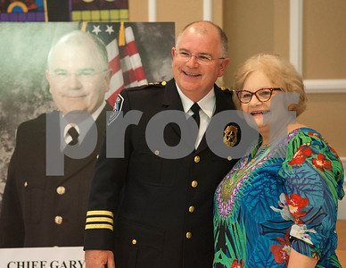 Tyler Police Chief Gary Swindle takes a photo with his aunt Carolyn Buckner during his retirement ceremony Thursday June 9, 2016 at Marvin Methodist Church. Swindle started as a patrol officer in 1982 was chief from 2000-2016.  (Sarah A. Miller/Tyler Morning Telegraph)