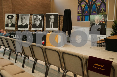 A photo of Tyler Police Chief Gary Swindle sits at right with photos of former chiefs during his retirement ceremony Thursday June 9, 2016 at Marvin Methodist Church. Swindle started as a patrol officer in 1982 was chief from 2000-2016.  (Sarah A. Miller/Tyler Morning Telegraph)