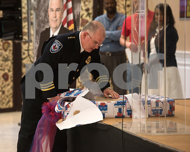 Tyler Police Chief Gary Swindle opens a gift from the City of Tyler Water Department at his retirement ceremony Thursday June 9, 2016 at Marvin Methodist Church. Swindle started as a patrol officer in 1982 was chief from 2000-2016.  (Sarah A. Miller/Tyler Morning Telegraph)