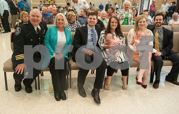 Tyler Police Chief Gary Swindle is pictured with his family at his retirement ceremony Thursday June 9, 2016 at Marvin Methodist Church. Swindle started as a patrol officer in 1982 was chief from 2000-2016. From left: Gary Swindle, Linda Swindle, Patrick Swindle, Bree Swindle, infant Emma Swindle, Amanda Rascusin, infant Madeline Racusin and Philip Rascusin.  (Sarah A. Miller/Tyler Morning Telegraph)