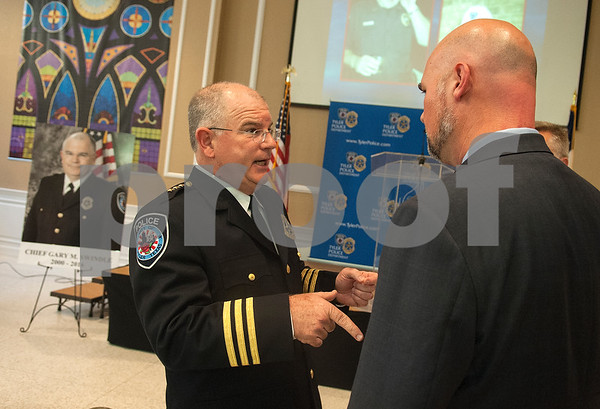 Tyler Police Chief Gary Swindle talks with city manager Ed Broussard his retirement ceremony Thursday June 9, 2016 at Marvin Methodist Church. Swindle started as a patrol officer in 1982 was chief from 2000-2016.   (Sarah A. Miller/Tyler Morning Telegraph)