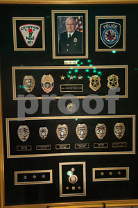 Tyler Police Chief Gary Swindle's badges are displayed at his retirement ceremony Thursday June 9, 2016 at Marvin Methodist Church. Swindle started as a patrol officer in 1982 was chief from 2000-2016.  (Sarah A. Miller/Tyler Morning Telegraph)