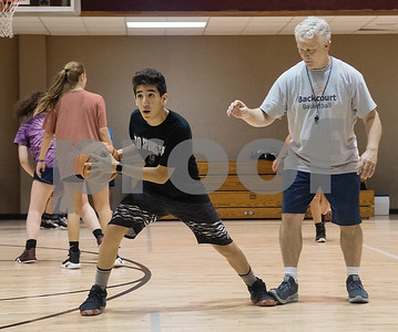 Manuel Thompson of  Harker Heights High School participates in a drill with coach Bill Winfrey at the Backcourt Basketball Skills Camp held at First Christian Church in Tyler on Tuesday July 10, 2018. The three day camp focuses on techniques and skills to help basketball players improve.    (Sarah A. Miller/Tyler Morning Telegraph)