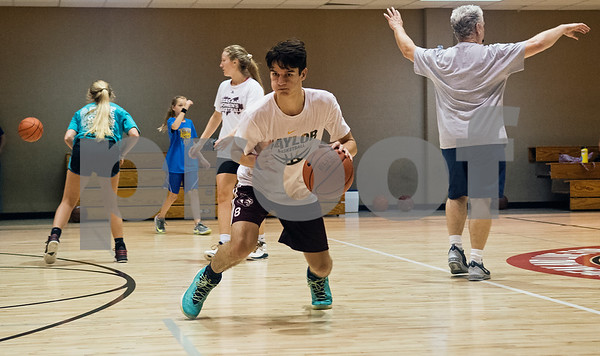Matt Wages of Palestine High School participates in the Backcourt Basketball Skills Camp held at First Christian Church in Tyler on Tuesday July 10, 2018. The three day camp focuses on techniques and skills to help basketball players improve.    (Sarah A. Miller/Tyler Morning Telegraph)