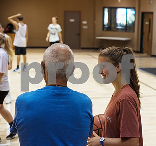 Hannah Burkes of Grace Community School talks with coach Larry Hargett during the Backcourt Basketball Skills Camp held at First Christian Church in Tyler on Tuesday July 10, 2018. The three day camp focuses on techniques and skills to help basketball players improve.    (Sarah A. Miller/Tyler Morning Telegraph)