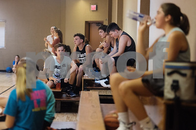 Campers at the Backcourt Basketball Skills Camp take a water break at First Christian Church in Tyler on Tuesday July 10, 2018. The three day camp focuses on techniques and skills to help basketball players improve.    (Sarah A. Miller/Tyler Morning Telegraph)