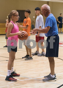 Cassidy Stewart of Van Junior High School talks with coach Larry Hargett during the Backcourt Basketball Skills Camp held at First Christian Church in Tyler on Tuesday July 10, 2018. The three day camp focuses on techniques and skills to help basketball players improve.    (Sarah A. Miller/Tyler Morning Telegraph)