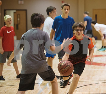 Blake Harmon of Grace Community School dribbles the ball during the Backcourt Basketball Skills Camp held at First Christian Church in Tyler on Tuesday July 10, 2018. The three day camp focuses on techniques and skills to help basketball players improve.    (Sarah A. Miller/Tyler Morning Telegraph)