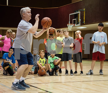 Bill Winfrey teaches a new skill for campers at the Backcourt Basketball Skills Camp held at First Christian Church in Tyler on Tuesday July 10, 2018. The three day camp focuses on techniques and skills to help basketball players improve.    (Sarah A. Miller/Tyler Morning Telegraph)