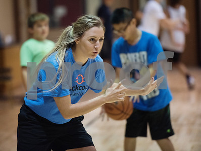 Former Alba-Golden High School basketball star Mickalea Moffett coaches students at the Backcourt Basketball Skills Camp held at First Christian Church in Tyler on Tuesday July 10, 2018. The three day camp focuses on techniques and skills to help basketball players improve.    (Sarah A. Miller/Tyler Morning Telegraph)