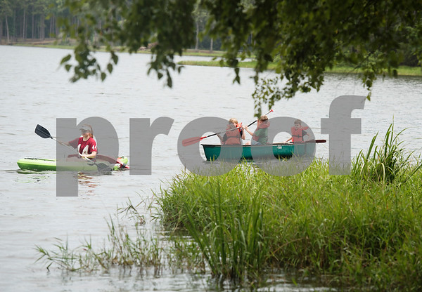 Lifeguard Shaylee Durst takes a group of campers out on a canoe during Texas Asthma Camp at Tyler Outdoor School on Tuesday July 10, 2018. Texas Asthma Camp is in its 33rd year. The summer camp is for students who have an asthma diagnosis and a doctor is on staff 24/7 at the camp.    (Sarah A. Miller/Tyler Morning Telegraph)
