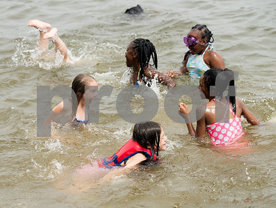 A group of girls swim during Texas Asthma Camp at Tyler Outdoor School on Tuesday July 10, 2018. Texas Asthma Camp is in its 33rd year. The summer camp is for students who have an asthma diagnosis and a doctor is on staff 24/7 at the camp.    (Sarah A. Miller/Tyler Morning Telegraph)