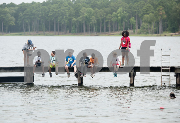 Texas Asthma Camp campers sit on the pier at Tyler Outdoor School on Tuesday July 10, 2018. Texas Asthma Camp is in its 33rd year. The summer camp is for students who have an asthma diagnosis and a doctor is on staff 24/7 at the camp.    (Sarah A. Miller/Tyler Morning Telegraph)