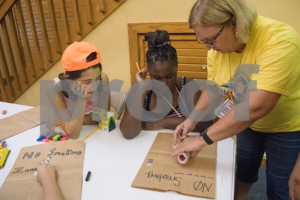 Campers Charli Maldonado, 11, of Tyler, and Reagan Valentine, 12, of Winnsboro, watch as camp nurse director Nancy Starkey traces a lung model onto a paper bag as an educational project about healthy lungs vs. a smoker's lungs during Texas Asthma Camp at Tyler Outdoor School on Tuesday July 10, 2018. Texas Asthma Camp is in its 33rd year. The summer camp is for students who have an asthma diagnosis and a doctor is on staff 24/7 at the camp.    (Sarah A. Miller/Tyler Morning Telegraph)