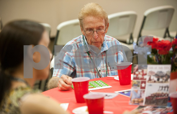 Participant Roger Singleton plays a Bingo game called Flags during the Wonderful Wednesdays Day Club at Shiloh Road Church of Christ in Tyler Wednesday July 1, 2015. The program is part of the Alzheimer's Alliance of Smith County and provides social and cognitive stimulation as well as lunch for people with Alzheimer's disease or dementia.   (photo by Sarah A. Miller/Tyler Morning Telegraph)