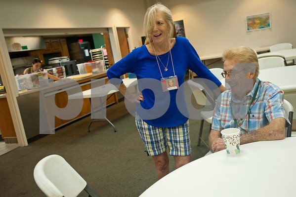 Volunteer Joanie Collier talks with participant Roger Singleton during the Wonderful Wednesdays Day Club at Shiloh Road Church of Christ in Tyler Wednesday July 1, 2015. The program is part of the Alzheimer's Alliance of Smith County and provides social and cognitive stimulation as well as lunch for people with Alzheimer's disease or dementia.   (photo by Sarah A. Miller/Tyler Morning Telegraph)