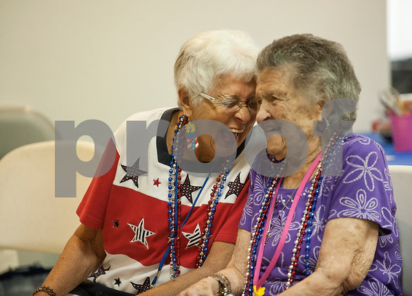 Participants Shirley Pearson and Julia Kucsan laugh and sing together during the Wonderful Wednesdays Day Club at Shiloh Road Church of Christ in Tyler Wednesday July 1, 2015. The program is part of the Alzheimer's Alliance of Smith County and provides social and cognitive stimulation as well as lunch for people with Alzheimer's disease or dementia.   (photo by Sarah A. Miller/Tyler Morning Telegraph)