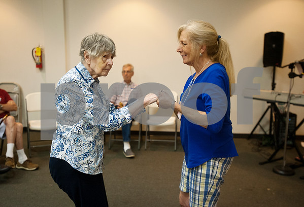 Participant Mary Tindel dances with volunteer Joanie Collier during the Wonderful Wednesdays Day Club at Shiloh Road Church of Christ in Tyler Wednesday July 1, 2015. The program is part of the Alzheimer's Alliance of Smith County and provides social and cognitive stimulation as well as lunch for people with Alzheimer's disease or dementia.   (photo by Sarah A. Miller/Tyler Morning Telegraph)