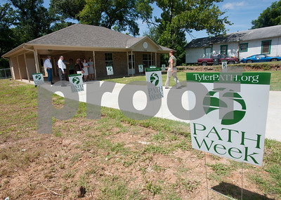 People arrive for the ribbon cutting ceremony for PATH's 54th home constructed in Tyler. The homes are rented to tenants at below-market rates as part of PATH's transitional housing program.  (photo by Sarah A. Miller/Tyler Morning Telegraph)