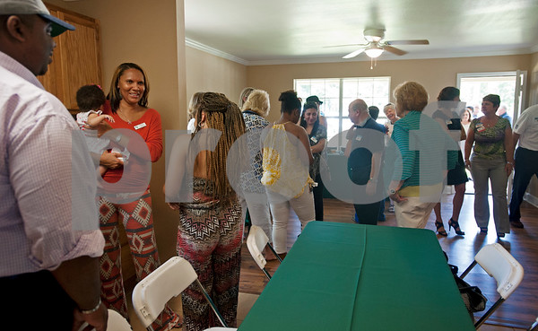 People tour a new rental home built by PATH for their transitional housing program Wednesday in Tyler.  (photo by Sarah A. Miller/Tyler Morning Telegraph)