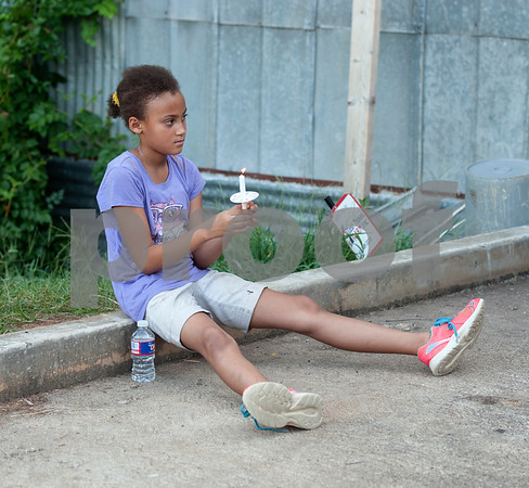 Guiliana Moore, 10, holds a candle during the Vigil for Freedom hosted by My African American Mothers' Alliance in Tyler Tuesday July 12, 2016. The event honored the lives of African Americans and Hispanic people killed by police as well as honoring members of the LBGT community who have died and the five law enforcement officers killed in Dallas during a peaceful protest.   (Sarah A. Miller/Tyler Morning Telegraph)