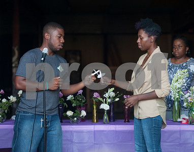 Ronald Hollins and Erricka Bailey light their candles during the Vigil for Freedom hosted by My African American Mothers' Alliance in Tyler Tuesday July 12, 2016. The event honored the lives of African Americans and Hispanic people killed by police as well as honoring members of the LBGT community who have died and the five law enforcement officers killed in Dallas during a peaceful protest.   (Sarah A. Miller/Tyler Morning Telegraph)