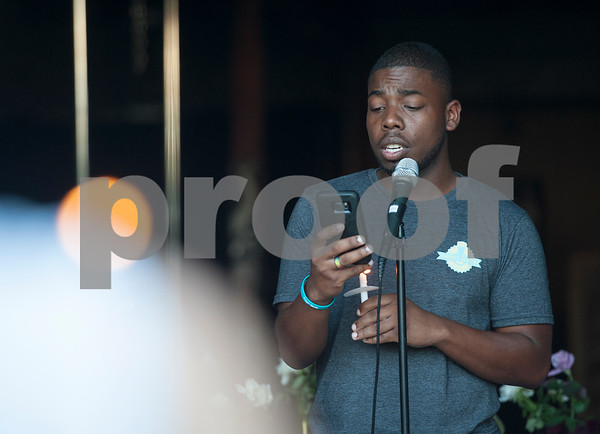 Ronald Hollins reads a list of names of people killed by police or in police custody during the Vigil for Freedom hosted by My African American Mothers' Alliance in Tyler Tuesday July 12, 2016.   (Sarah A. Miller/Tyler Morning Telegraph)