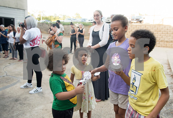 Lehi Walker, 4, Annetta Taylor, 4, Guilianna Moore, 10, and Aydan Taylor, 8, light each other's candles during the Vigil for Freedom hosted by My African American Mothers' Alliance in Tyler Tuesday July 12, 2016.   (Sarah A. Miller/Tyler Morning Telegraph)