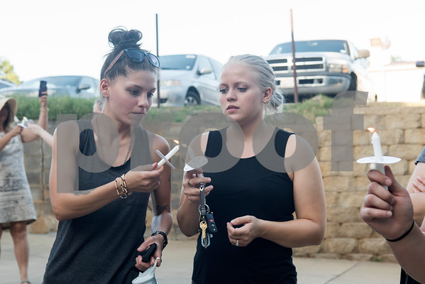 Koreen Hammond and Kaleigh Kennedy of Tyler light their candles during the Vigil for Freedom hosted by My African American Mothers' Alliance in Tyler Tuesday July 12, 2016. The event honored the lives of African Americans and Hispanic people killed by police as well as honoring members of the LBGT community who have died and the five law enforcement officers killed in Dallas during a peaceful protest.   (Sarah A. Miller/Tyler Morning Telegraph)