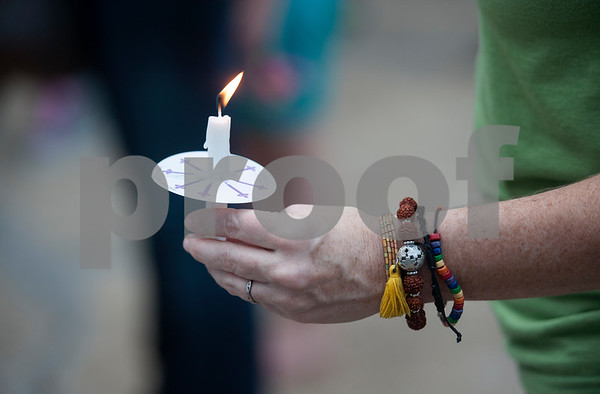 Beth Lytle holds a candle during the Vigil for Freedom hosted by My African American Mothers' Alliance in Tyler Tuesday July 12, 2016. The event honored the lives of African Americans and Hispanic people killed by police as well as honoring members of the LBGT community who have died and the five law enforcement officers killed in Dallas during a peaceful protest.   (Sarah A. Miller/Tyler Morning Telegraph)
