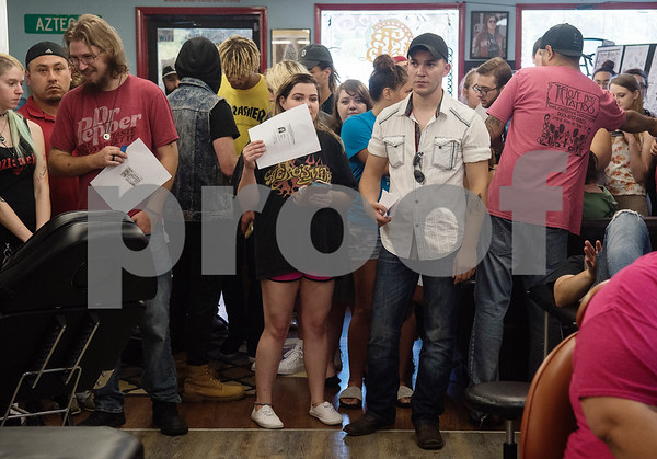 People pack the lobby waiting for their turn to get a tattoo for the Friday the 13th special at The Lost Boys Tattoo Shop in Tyler on Friday July 13, 2018. It's an unofficial tradition at many tattoo parlors to offer specials on specific horror-themed or small tattoos on Friday the 13th. Some of the tattoo designs include the number 13. The Lost Boys Tattoo Shop had more than 50 tattoos to choose from, each costing $13 plus a $7 suggested tip.   (Sarah A. Miller/Tyler Morning Telegraph)