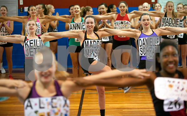 Keilin Jeter of Whitehouse, Maddie Minser of Whitehouse and Danielle Schraer of Richmond practice a high kick line during practice for tryouts for the Kilgore College Rangerettes Wednesday July 15, 2015. Over 90 hopefuls attended practices this week at the Rangerette Gym in Kilgore, Texas leading up to team tryouts Thursday. The Rangerettes is a dancing drill team started in 1940 to perform at football games during halftime. Girls will find out if they made the team Friday.   (photo by Sarah A. Miller/Tyler Morning Telegraph)