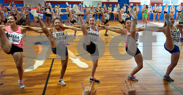 Young women practice a high kick line during practice for tryouts for the Kilgore College Rangerettes Wednesday July 15, 2015. Over 90 hopefuls attended practices this week at the Rangerette Gym in Kilgore, Texas leading up to team tryouts Thursday. The Rangerettes is a dancing drill team started in 1940 to perform at football games during halftime. Girls will find out if they made the team Friday.   (photo by Sarah A. Miller/Tyler Morning Telegraph)