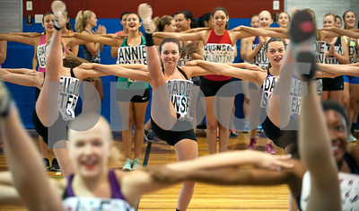 Young women including Maddie Minser, 18, of Whitehouse, center, practice a high kick line during practice for tryouts for the Kilgore College Rangerettes Wednesday July 15, 2015. Over 90 hopefuls attended practices this week at the Rangerette Gym in Kilgore, Texas leading up to team tryouts Thursday. The Rangerettes is a dancing drill team started in 1940 to perform at football games during halftime. Girls will find out if they made the team Friday.   (photo by Sarah A. Miller/Tyler Morning Telegraph)