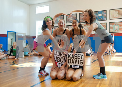 Two advisors take a photos with their hopefuls during practice for tryouts for the Kilgore College Rangerettes Wednesday July 15, 2015. Over 90 hopefuls attended practices this week at the Rangerette Gym in Kilgore, Texas leading up to team tryouts Thursday. The Rangerettes is a dancing drill team started in 1940 to perform at football games during halftime. Girls will find out if they made the team Friday. Pictured from left top: Rangerette Samantha Fink, hopeful Kati Scroggins of Keller, hopeful Cameron Maldonado of Austin, Rangerette Breanne Gardner, (bottom row) hopeful Lauren Ligon of Richardson and hopeful Kasey Davis of Carrollton.   (photo by Sarah A. Miller/Tyler Morning Telegraph)