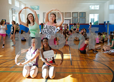 Rangerette Brianna George, top left, does the four leaf clover pose with hopefuls Lauren Kazemba of Lantana, Alex Dawson of Carrollton and Precious Richardson of Marshall during practice for tryouts for the Kilgore College Rangerettes Wednesday July 15, 2015. Over 90 hopefuls attended practices this week at the Rangerette Gym in Kilgore, Texas leading up to team tryouts Thursday. The Rangerettes is a dancing drill team started in 1940 to perform at football games during halftime. Girls will find out if they made the team Friday.   (photo by Sarah A. Miller/Tyler Morning Telegraph)