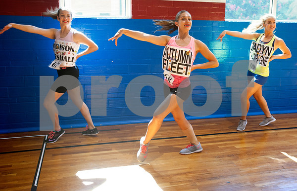 Madison Marshall of Midlothian, Autumn Fleet of Tyler and Jadyn Champagne of Plano run through a dance during practice for tryouts for the Kilgore College Rangerettes Wednesday July 15, 2015. Over 90 hopefuls attended practices this week at the Rangerette Gym in Kilgore, Texas leading up to team tryouts Thursday. The Rangerettes is a dancing drill team started in 1940 to perform at football games during halftime. Girls will find out if they made the team Friday.   (photo by Sarah A. Miller/Tyler Morning Telegraph)