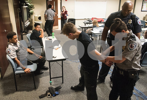Students practice proper handcuffing procedures during the Tyler Police Department's Explorer Post No. 310 meeting June 28, 2017. The program meets every Tuesday and allows students to explore careers in law enforcement.  (Sarah A. Miller/Tyler Morning Telegraph)