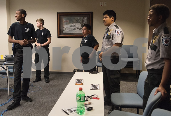 Xavier Johnson, 16, Judah Wilson, 16, Alexis Gonzales, 15, Edvin Gutierrez, 19, and Chris Jackson, 17, listen to instructions during the Tyler Police Department's Explorer Post No. 310 meeting June 28, 2017.   (Sarah A. Miller/Tyler Morning Telegraph)