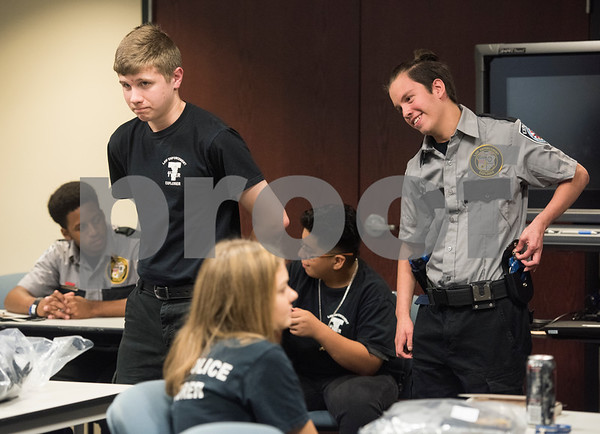 Students Judah Wilson and Rito Ocanas practice handcuffing during the Tyler Police Department's Explorer Post No. 310 meeting June 28, 2017. The program meets every Tuesday and allows students to explore careers in law enforcement.  (Sarah A. Miller/Tyler Morning Telegraph)