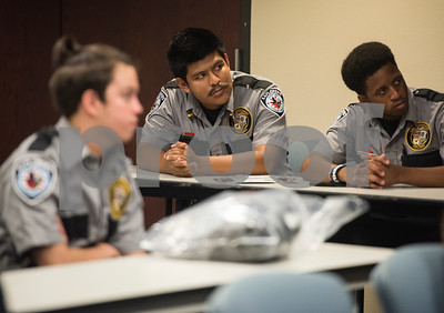Edvin Gutierrez, 19, and Chris Jackson, 17, listen to instructions during the Tyler Police Department's Explorer Post No. 310 meeting June 28, 2017. Gutierrez and Jackson have both been in the Explorer program for three years.  (Sarah A. Miller/Tyler Morning Telegraph)