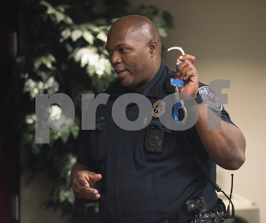 Tyler Police Department Community Response Officer Shane Jasper instructs students on proper handcuffing procedures during the Tyler Police Department's Explorer Post No. 310 meeting June 28, 2017. The program meets every Tuesday and allows students to explore careers in law enforcement.  (Sarah A. Miller/Tyler Morning Telegraph)