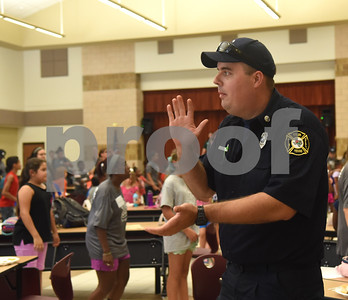 Tyler fire fighter Adam Dixon dances with children before lunch at the Rose City Summer Camps Public Safety Appreciation Day at Dixie Elementary School Wednesday July 20, 2016.  (Sarah A. Miller/Tyler Morning Telegraph)