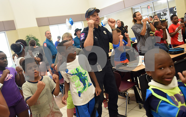Tyler fire fighter Jon Wilbeck dances with children before lunch at the Rose City Summer Camps Public Safety Appreciation Day at Dixie Elementary School Wednesday July 20, 2016.  (Sarah A. Miller/Tyler Morning Telegraph)