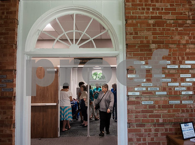 People tour the remodeled Tyler Woman's Building,  911 South Broadway Avenue, during an open house for the United Way of Smith County which is now headquartered there. The historic building, built in 1932, was remodeled by Fitzpatrick Architects.  (Sarah A. Miller/Tyler Morning Telegraph)
